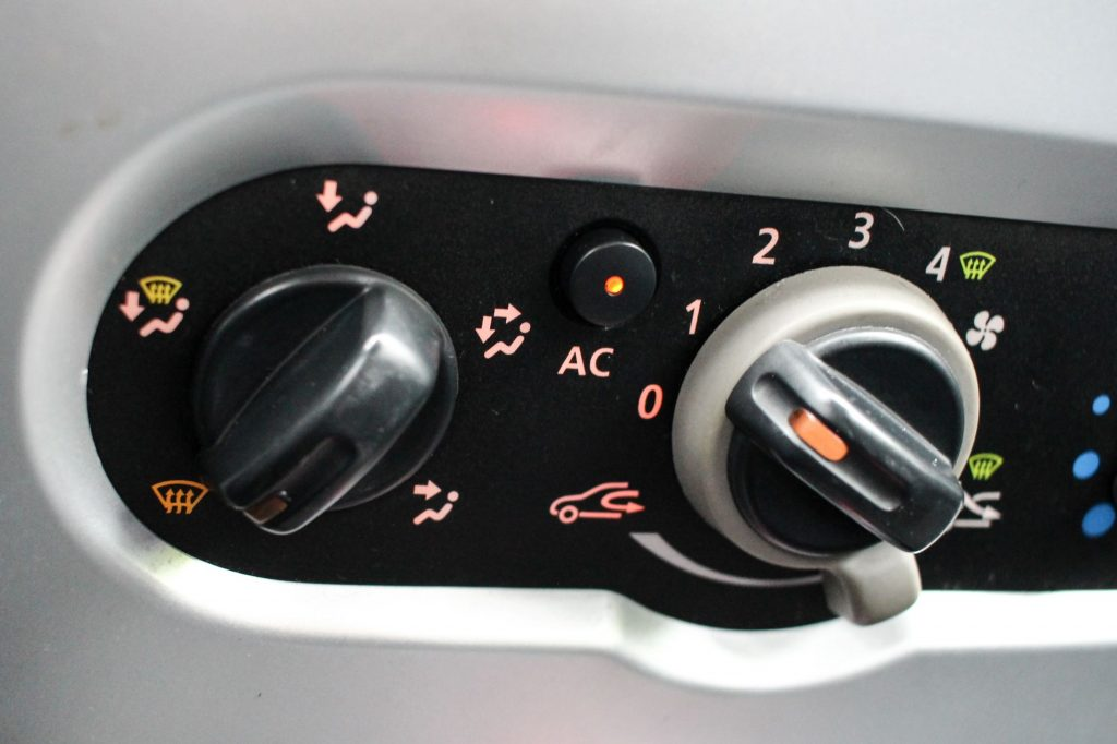 An air conditioning button and switch panel in an old car