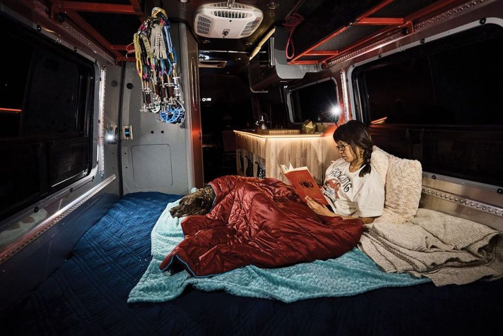 woman sleeping in the fold out bed of the Interstate 24X