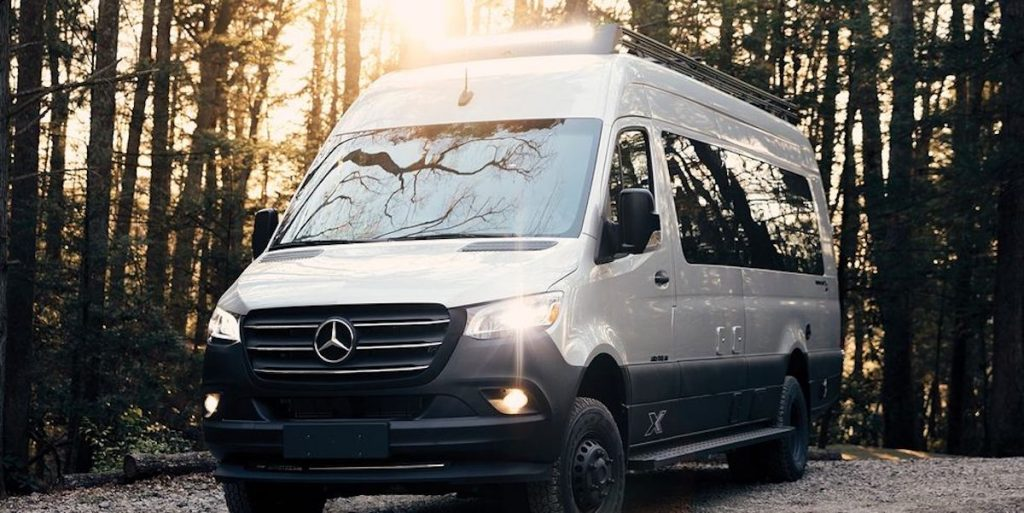 Airstream Camper van in white with lights