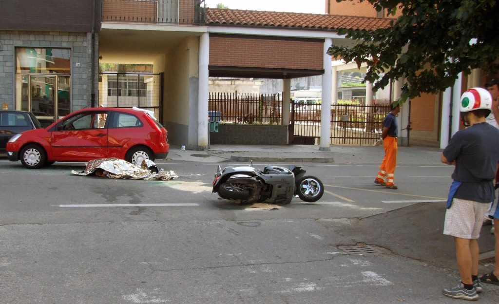 The body of Andrea Pininfarina, CEO of the famed Italian car design firm, lies in the street after he died in an car accident in Italy in August 2008