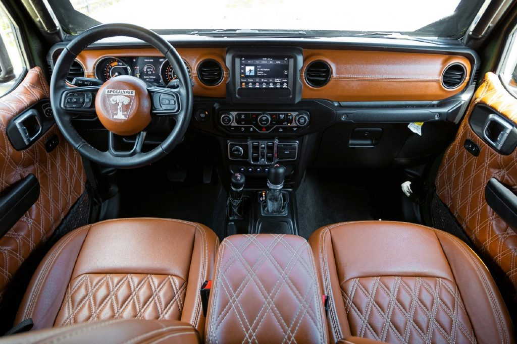 The brown-and-black front seats and dashboard of an Apocalypse Hellfire 6x6