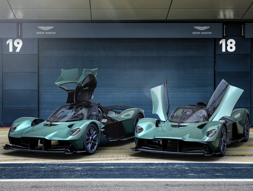 The Aston Martin Valkyrie Spider parked next to the Aston Martin Valkyrie coupe.