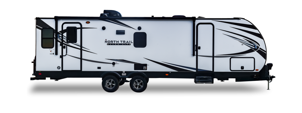 a North Trail travel trailer in a press photo against a white backdrop