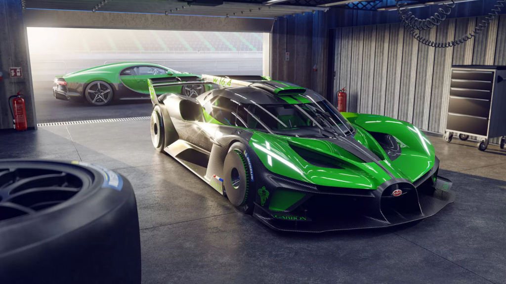 A green Bugatti Bolide race car parked in a garage next to a racetrack