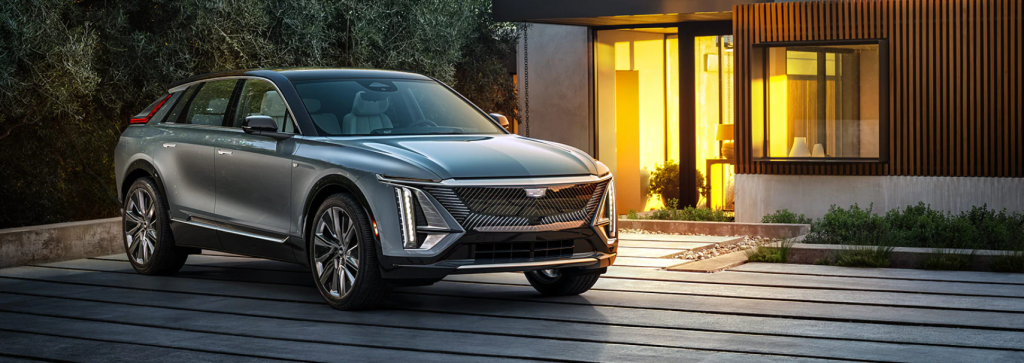 The Cadillac Lyriq EV SUV parked outside a luxury home