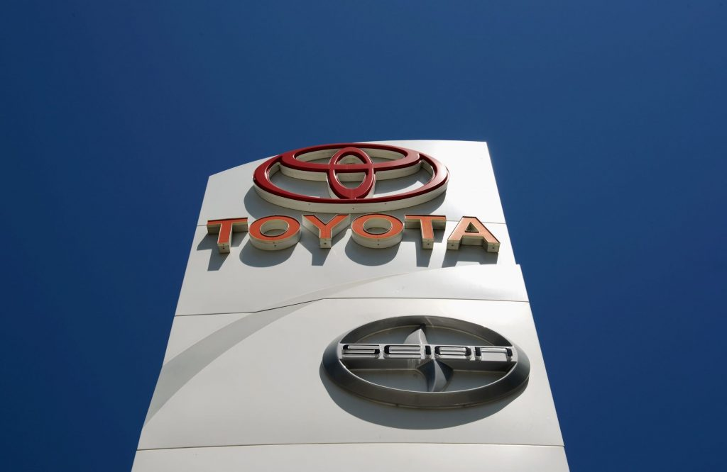 A car dealership sign with the Toyota and Scion logos located in Los Angeles, California