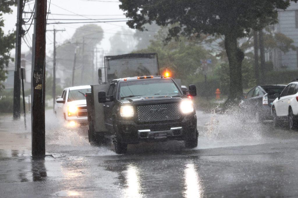 Cars Driving Through Heavy Rain With Hazard Lights On