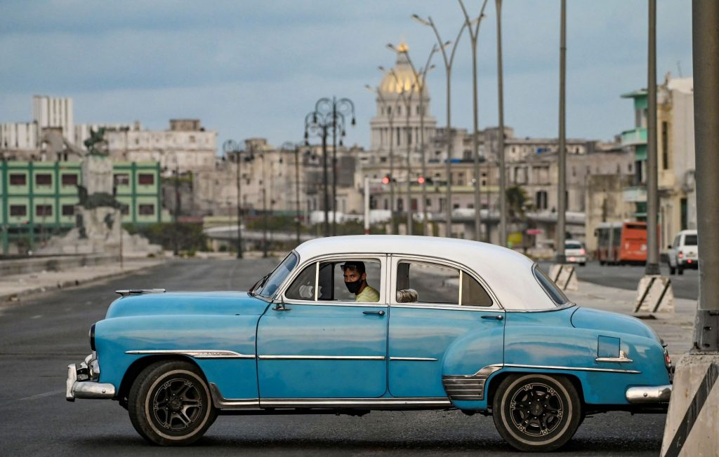 An old American car driving in the streets of Havana, Cuba