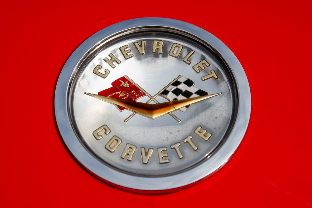 The classic Chevrolet Corvette logo with the two flags and the gold V with 'Chevrolet Corvette' written on it.