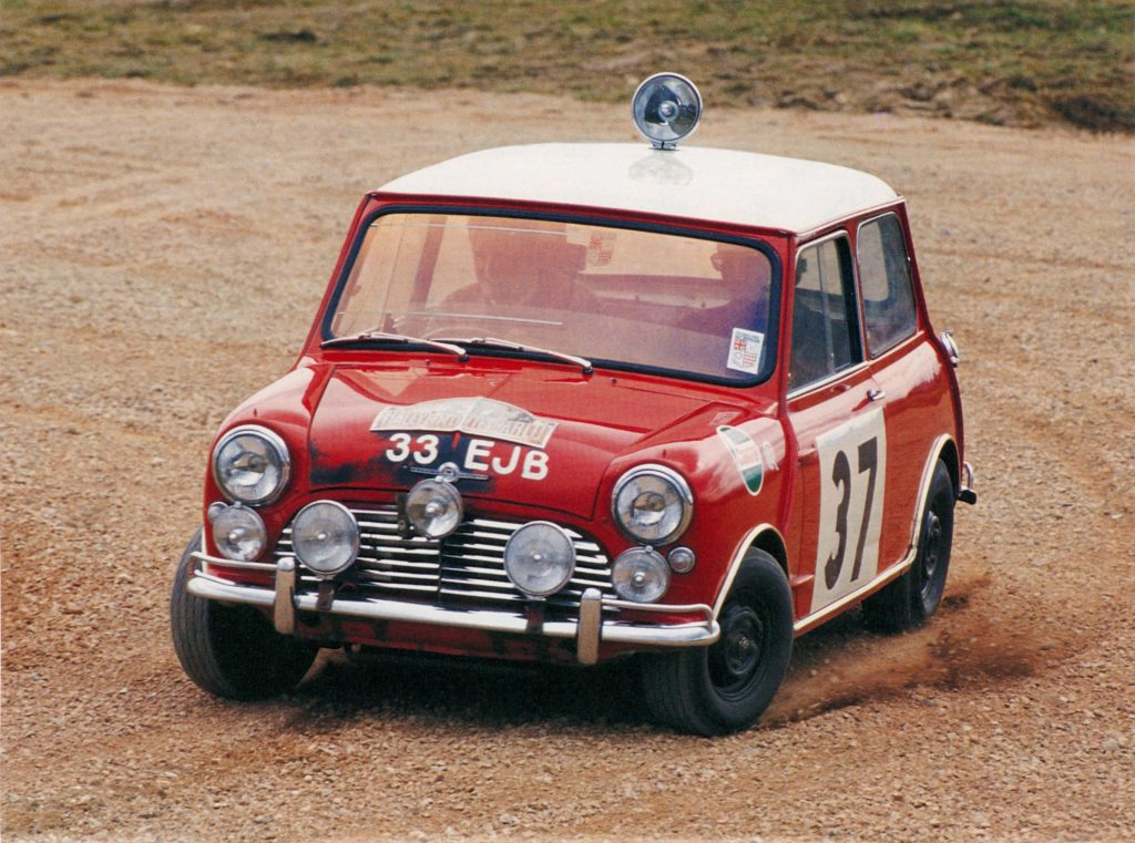 A red-and-white classic Mini Cooper S at the 1964 Monte Carlo Rally
