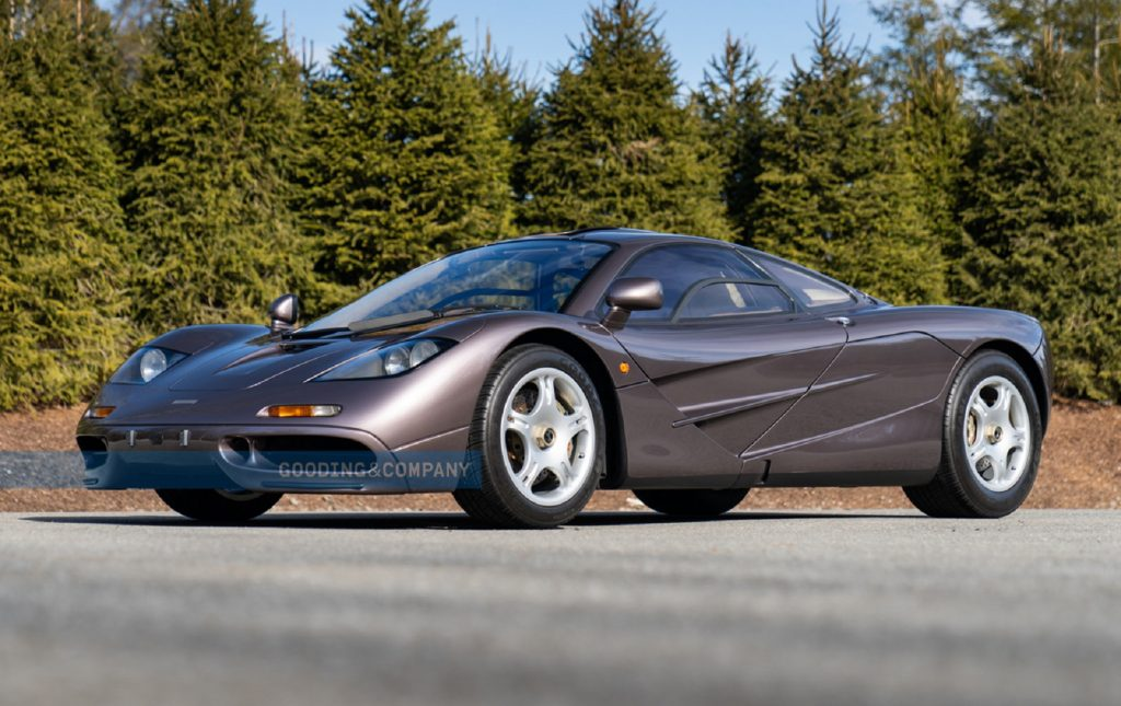 The Creighton Brown 1995 McLaren F1 parked by some pine trees