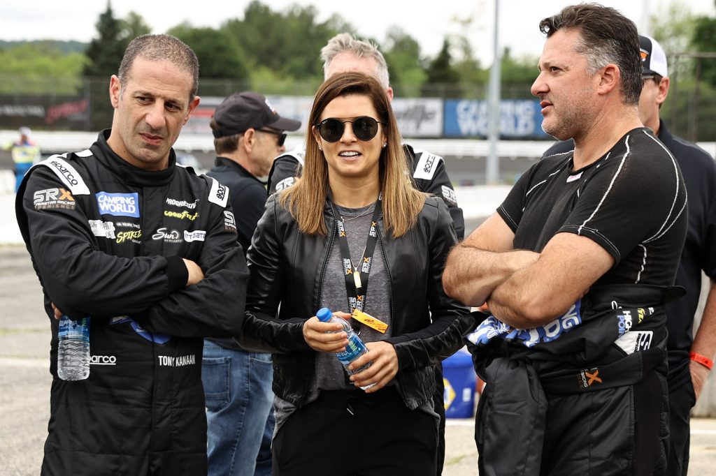CBS driver analyst Danica Patrick talks with SRX drivers Tony Kanaan (left) and Tony Stewart on the grid prior to the Inaugural Superstar Racing Experience Event at Stafford Motor Speedway on June 12, 2021, in Stafford Springs, Connecticut. Patrick is one of few women in motorsports.