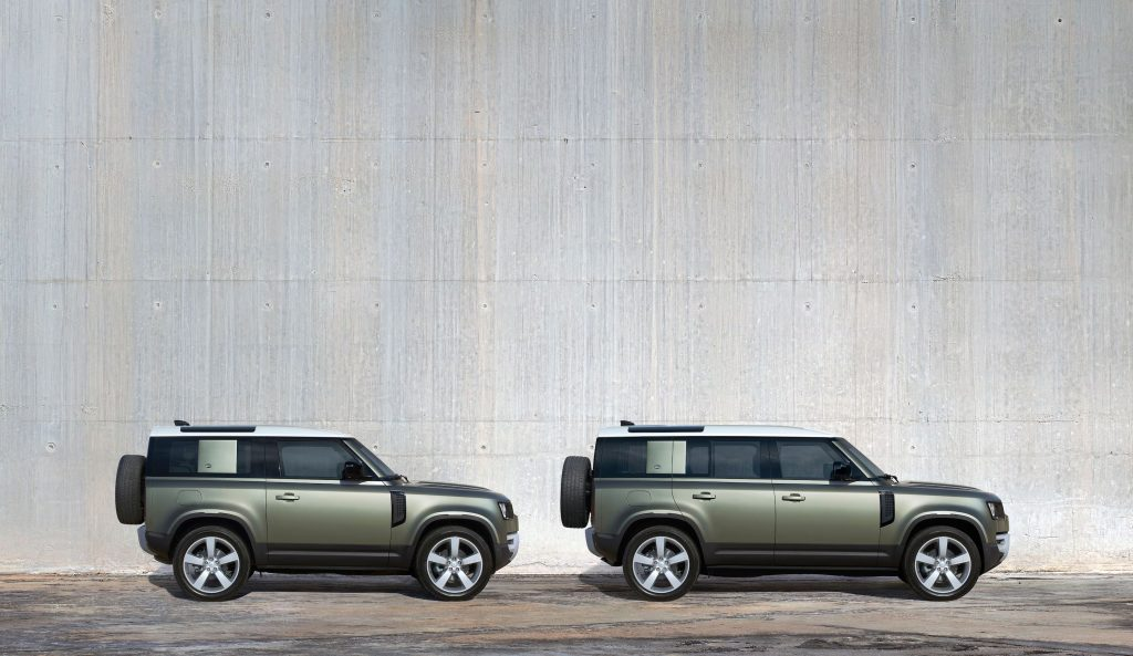 a pair of new Defenders. One is the four-door 110 and the other is the two-door Defender 90