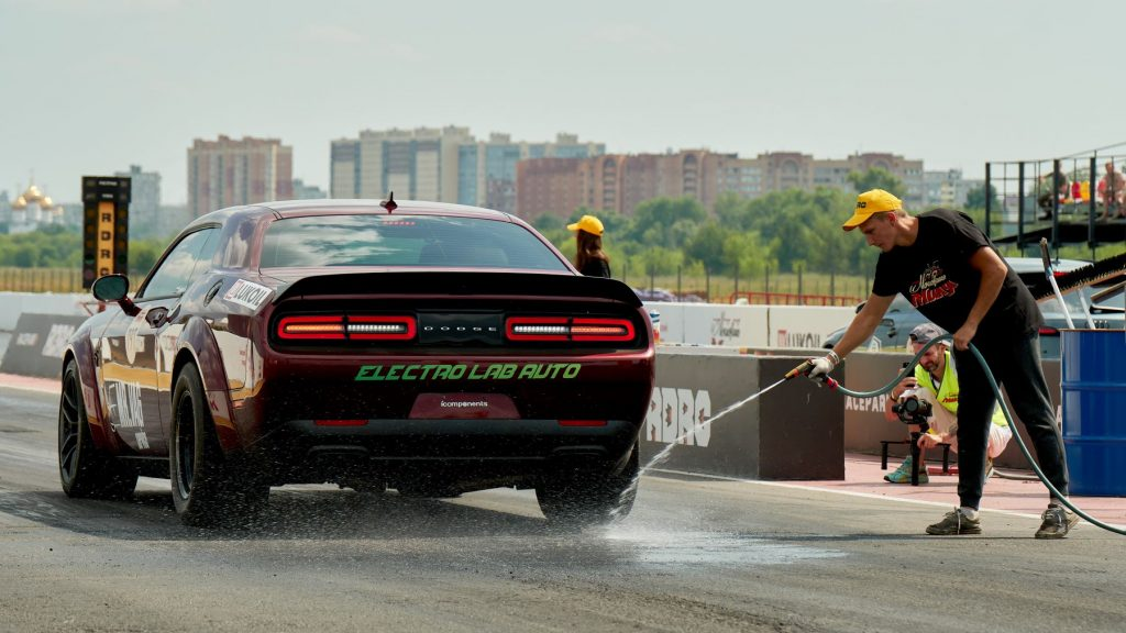 """A Dodge Challenger getting hosed down before a race at the """"Moscow Mile"""""""