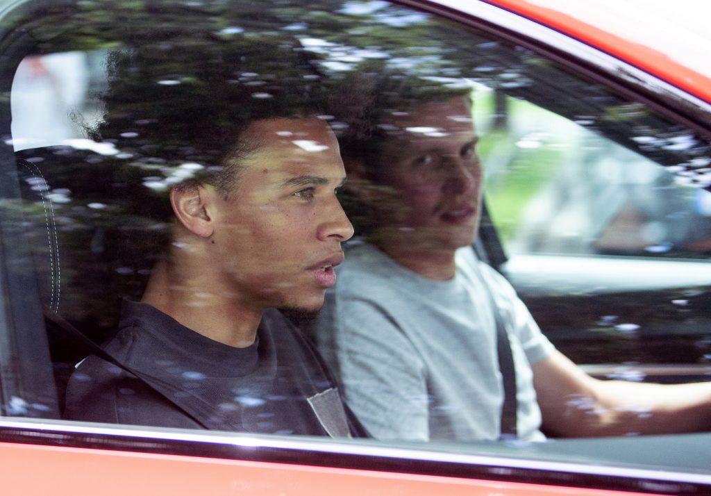 Man Riding Shotgun In The Passenger's Seat Of Car