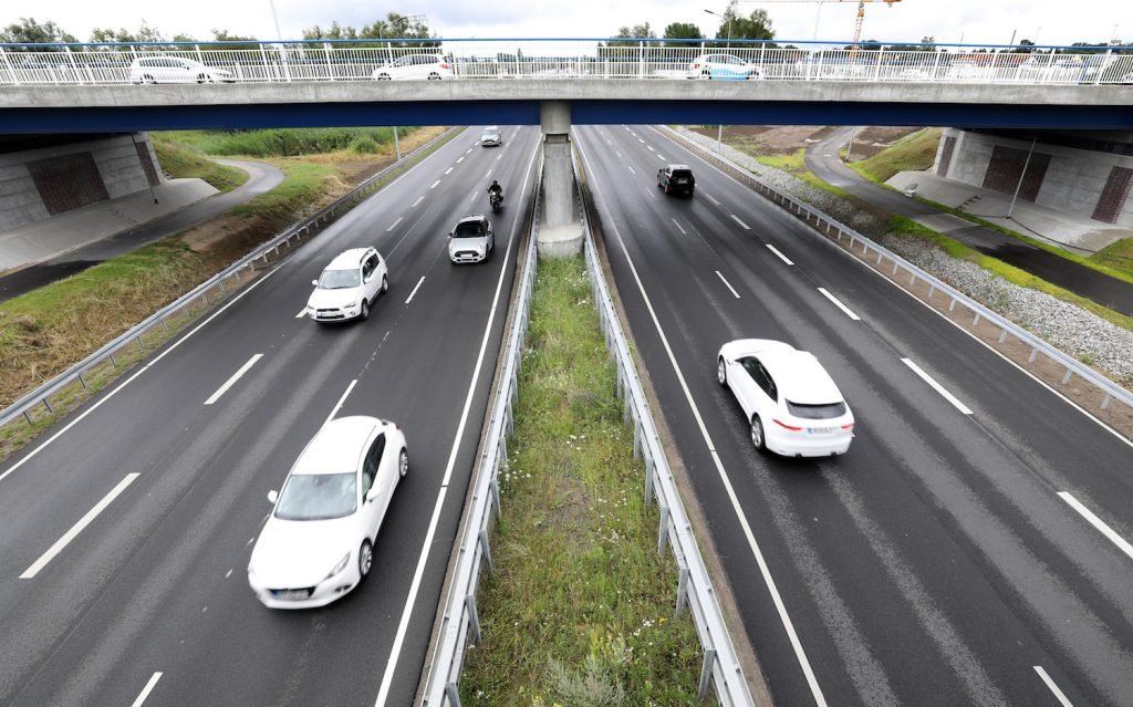 Cars driving down a highway, if you want your car to last, breaking in a new car is a good idea