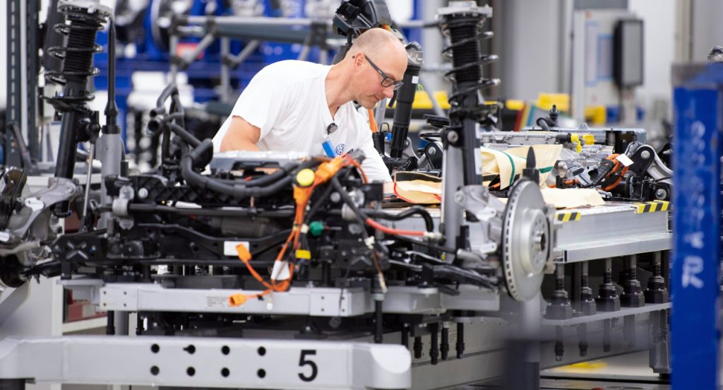 Volkswagen employees wire the battery on a line for the VW ID.3 electric vehicle during a press tour of Volkswagen's Transparent Factory. 35 all-electric vehicles are produced daily at the Dresden site.