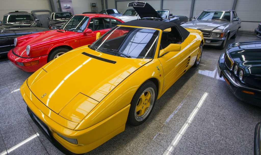A yellow Ferrari 348 Spider model parked in a showroom in Pomerania, Germany