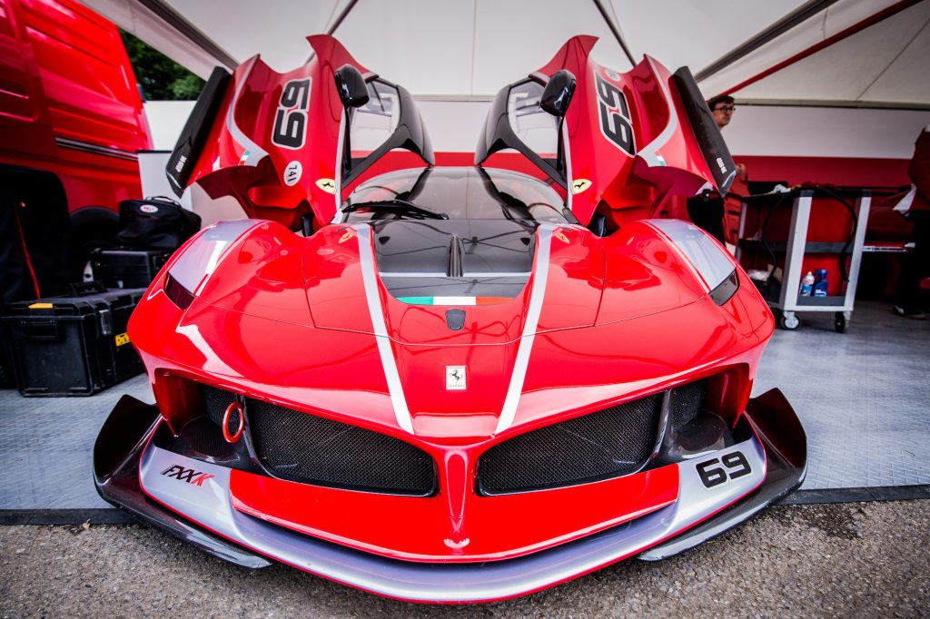 A red Ferrari FXX-K, among the top 5 most expensive Ferraris, sits in the paddock awaiting its driver and passenger to tackle the Goodwood Hillclimb in June 2016