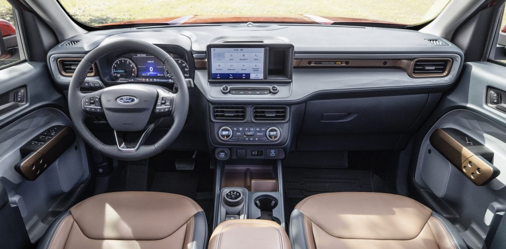 A wide shot of the Maverick's interior with tan upholstery and a wireless charging pad