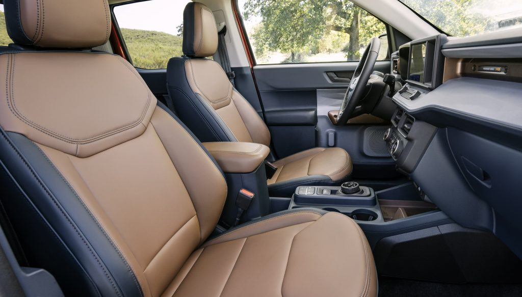 The interior of the new Maverick with a low center console and tan leather seats