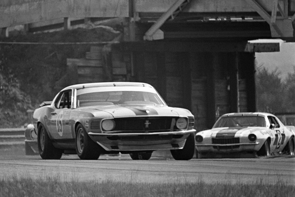 A Ford Mustang on an outdoor racetrack.