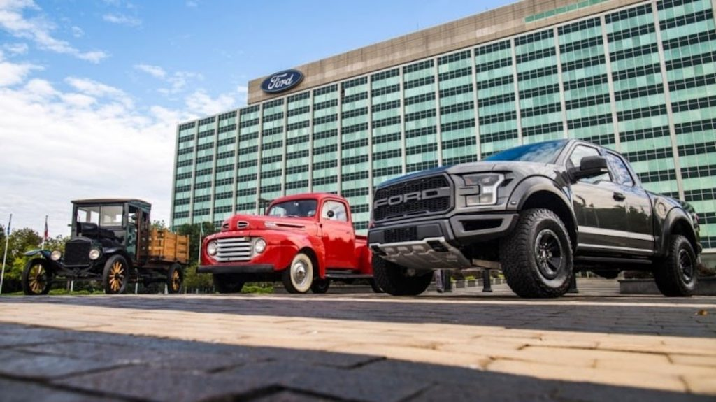 This publicity shot is a lineup of Ford trucks from over a century of truck building. Ford F-150 VS Toyota Land Cruiser: Which Is More Iconic?