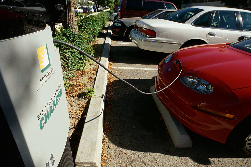 GM EV1 first mass-produced all-electric car being charged