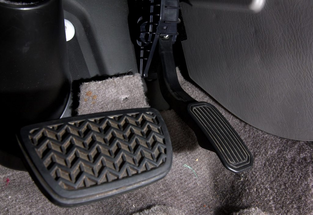 The gas and brake pedals in a Toyota vehicle from a lot in San Diego, California
