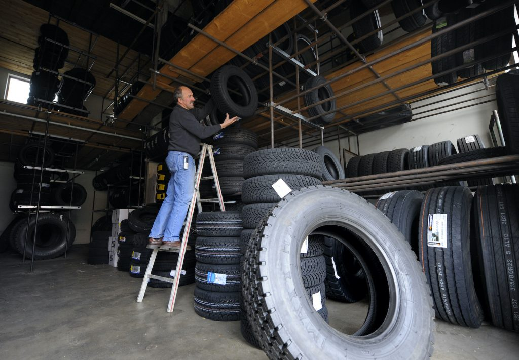 Common tire types and ideas for aftermarket tire upgrades. An employee stores new winter tyres in a small garage in Ingolstadt, southern Germany, on November 26, 2010. The upper house of parliament (Bundesrat) decided on November 26 that  Germany's car drivers are obliged to have snow tyres on their vehicles from the end of November on during the winter season.  AFP PHOTO / CHRISTOF STACHE (Photo credit should read CHRISTOF STACHE/AFP via Getty Images)