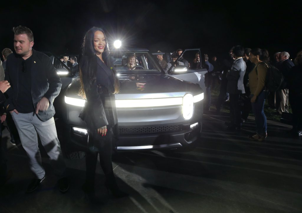 LOS ANGELES, CALIFORNIA - NOVEMBER 26: Rihanna attends Rivian Unveils First-Ever Electric Adventure Vehicle Before Its Official Reveal At The LA Auto Show at Griffith Observatory on November 26, 2018 in Los Angeles, California. (Photo by Phillip Faraone/Getty Images for Rivian)   Rivian IPO: Backed By Amazon And Ford, Startup Files For $80 Billion