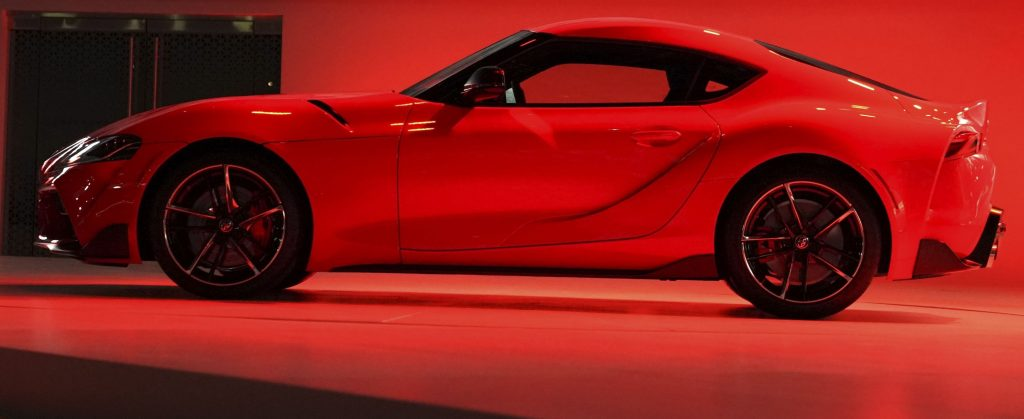 2020 Toyota Supra against a red back drop is also included in the BMW recall