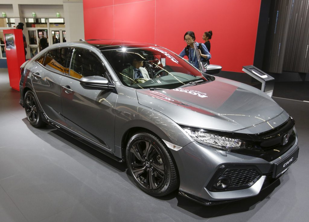 A Honda Civic on display at an indoor auto show is one of the most satisfying 2021 Honda models according to Consumer Reports