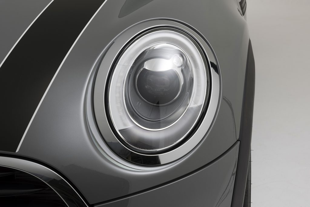 The front headlight of a 2017 Mini Cooper