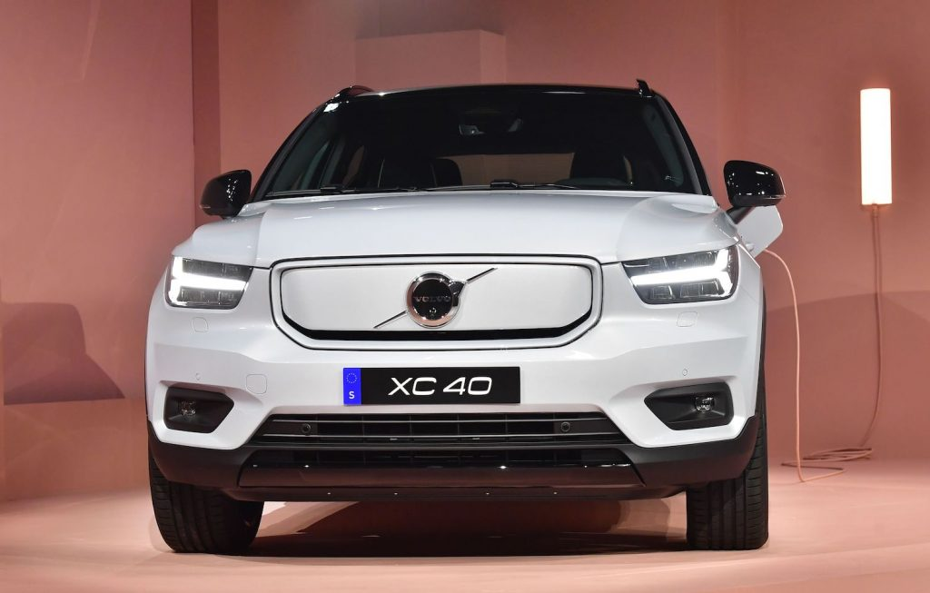 A white Volvo XC40 recharge pure EV at a press event. The XC40 Recharge EV is among the best electric SUVs of 2021.