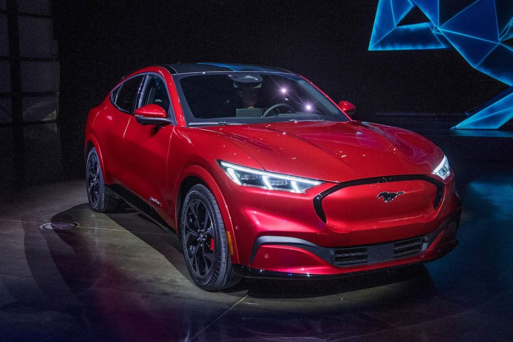 Ford reveals its first mass-market electric car the Mustang Mach-E, which is an all-electric vehicle that bears the name of the companys iconic muscle car at a ceremony in Hawthorne, California on November 17, 2019. - This is Ford's first serious attempt at making a long-range EV and will be the flagship of a new lineup that will include an electric F-150 pickup truck.