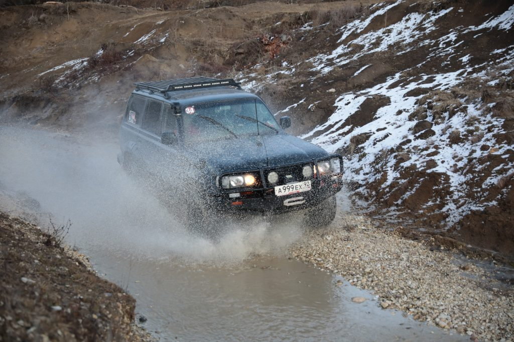 A modified SUV participates in an off-road rally in Russia