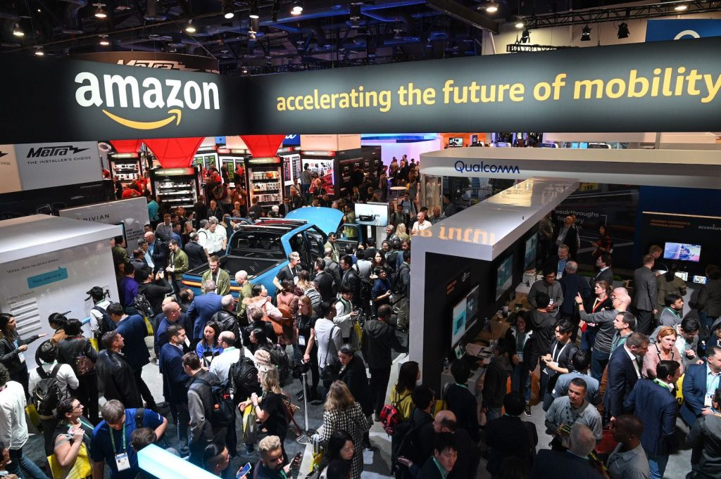 Attendees visit the Amazon booth where a Rivian electric truck with Amazon Alexa integration is displayed, January 7, 2020, at the 2020 Consumer Electronics Show (CES) in Las Vegas, Nevada. (Photo by Robyn Beck / AFP) (Photo by ROBYN BECK/AFP via Getty Images)   Rivian IPO: Backed By Amazon And Ford, Startup Files For $80 Billion