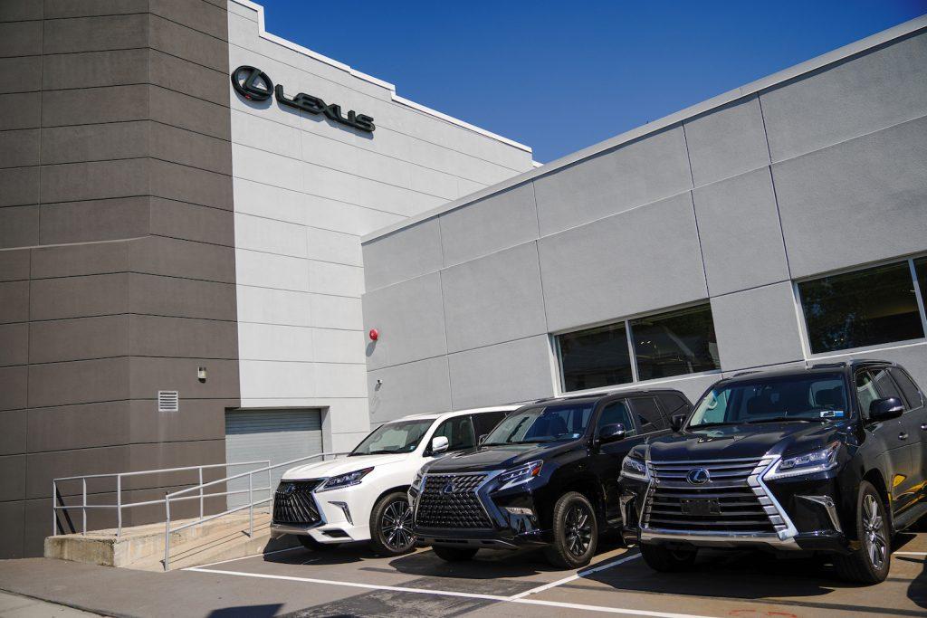 Three 2020 Lexus SUVs outside a Lexus dealership. Not pictured: the 2022 Lexus LX