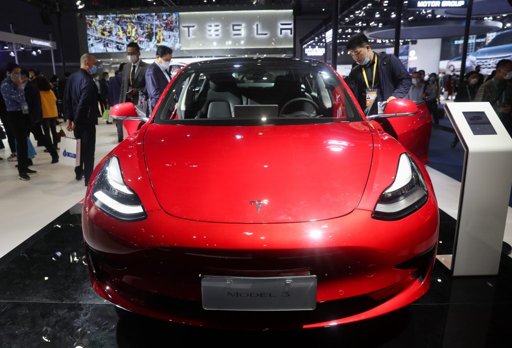 A red Tesla Model 3 electric car is seen at the Automobile exhibition area during the third China International Import Expo CIIE in Shanghai, east China, Nov. 6, 2020.