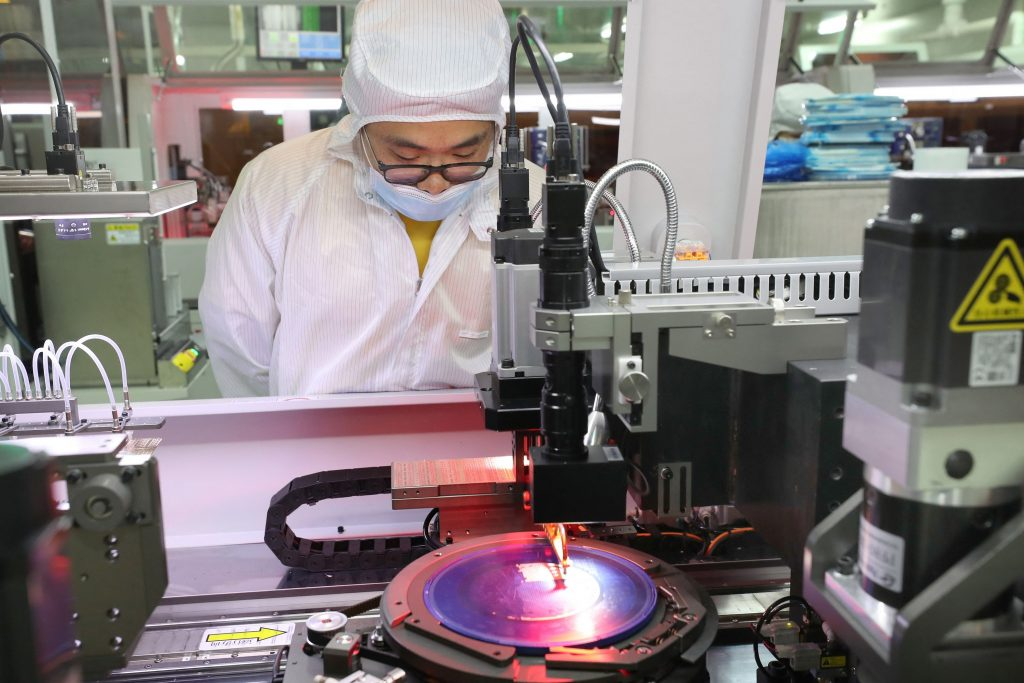 A man in a clean room manufactures semiconductors