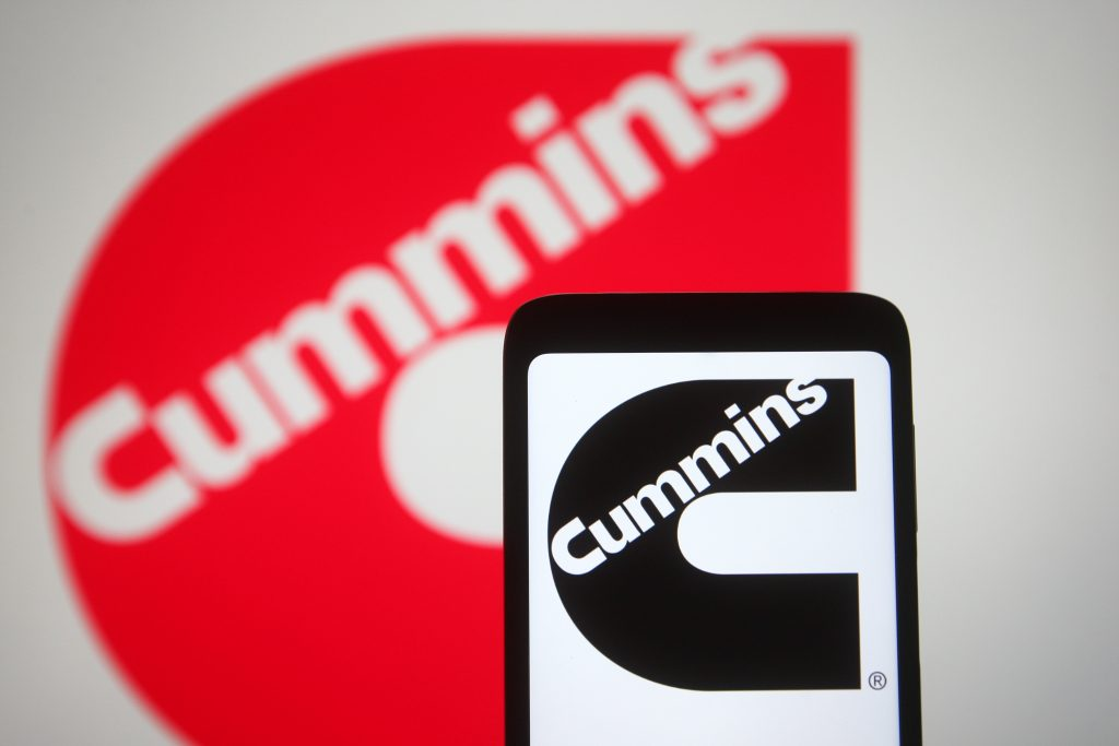 The red cummins diesel logo with a smart phone also displaying the logo in black and white