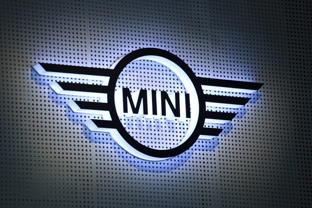 The Mini logo backlit and displayed on a wall
