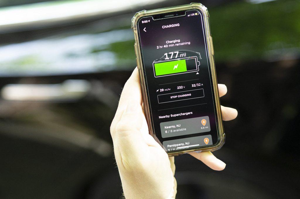 The Tesla charging display on an iPhone