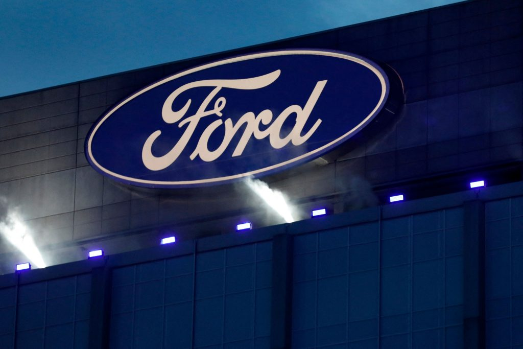 The blue oval Ford Motor Company logo on the side of a Ford truck factory