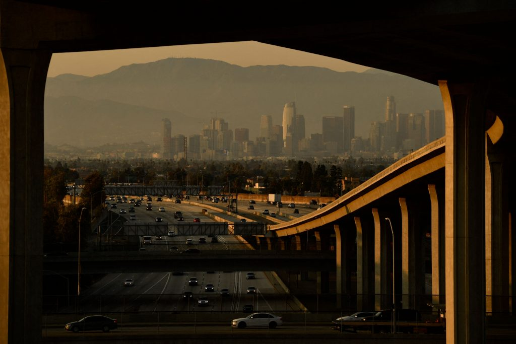 LA's skyline at sunset, photographed from the highway