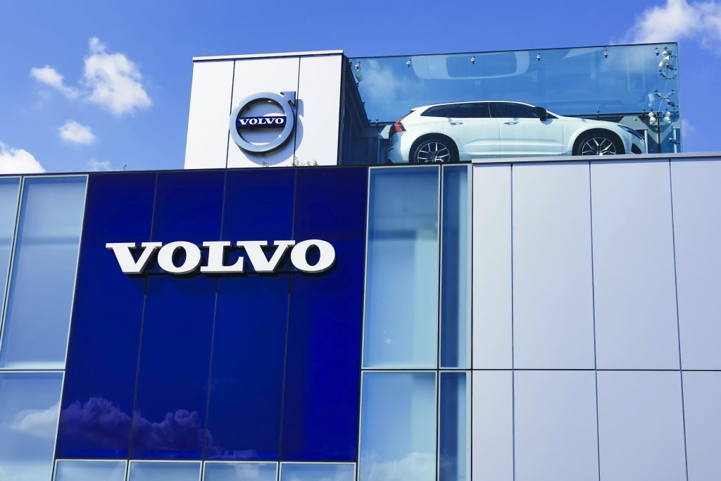 a Volvo building with the logo and a display car