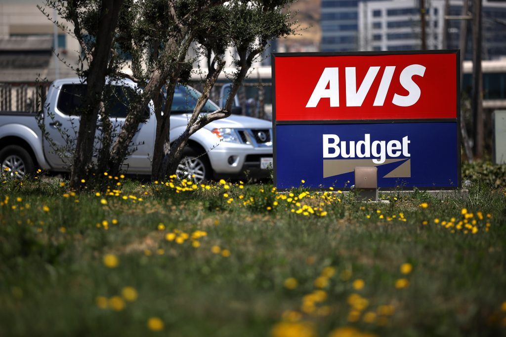 An Avis/Budget sign outside a location in San Francisco, CA