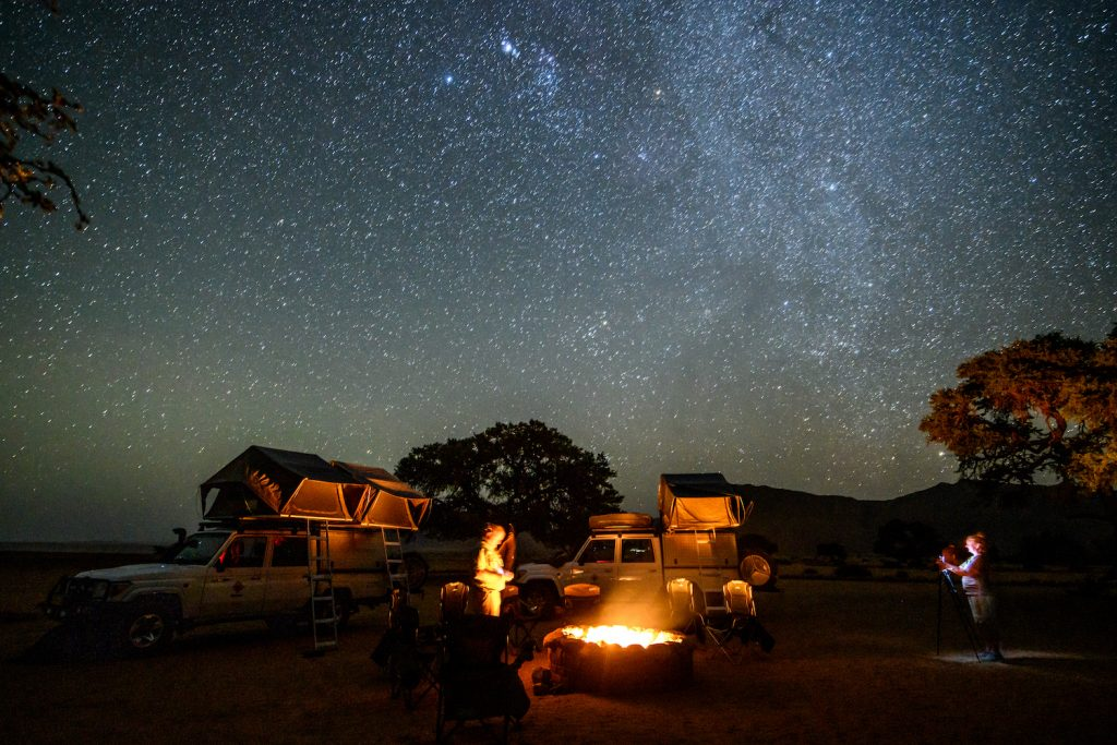 Overland Camping Shelter Options: A campsite set up under the wondrous night sky , Helmeringhausen, Namibia. (Photo by: Edwin Remsberg/VWPics/Universal Images Group via Getty Images)