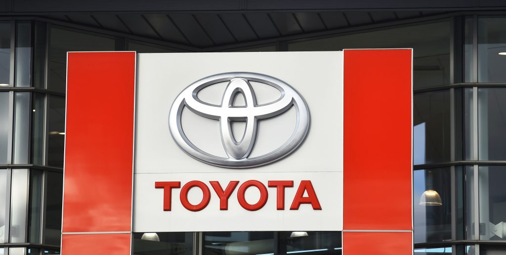 a Toyota logo outside of the storefront of a Toyota dealership